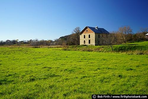 Barns;agriculture;country;farm;farm buildings;Wisconsin;WI;rural;midwest farm;pasture;farm field;farmstead;grasses;stone barn;barn built from stone;fall;autumn;fall trees
